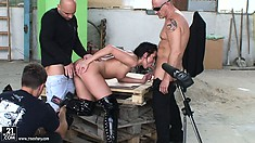 Backstage action where brunette takes on two cocks for the camera