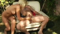 Blonde beauty with sexy tits has a horny guy hammering her ass outside