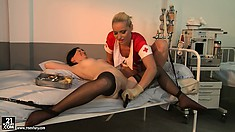 Angry nurse in rubber gloves searches for wet cunt of her patient