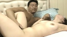 Sexy Japanese wife has her horny husband fucking her pussy on the bed