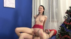 Striking brunette uses the art of seduction to get fucked by the Santa