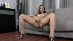 Brunette shows off her sweet ass before she fingers and toys it