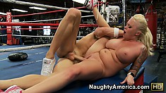 Knock-out blonde bimbo with huge tits gets fucked in the ring