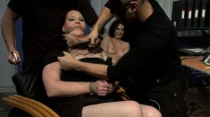 Gorgeous secretaries playing out their bondage fantasies at the office