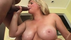 Hot babe with big tits eats his meat and gets her slit hammered
