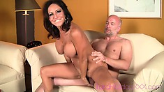 Dazzling brunette milf with splendid boobs sucks a big cock and rides it with passion
