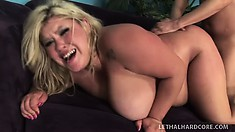 She chews on his meat again, goes doggy and gives him a titty fuck