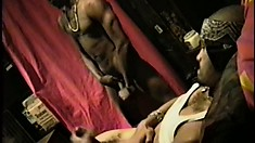 A couple of gay black hunks jerk off together next to each other