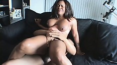 Voluptuous ebony babe with a big booty rides a huge black cock with great desire