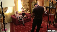 Stacy and Silvia Saint making out on the sofa while a guy films all the action