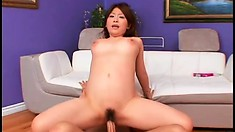 Petite Asian broad stops using her toys and takes a real dicking