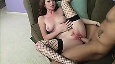 Gorgeous babe in black fishnet stockings has a pink snatch craving for a big cock
