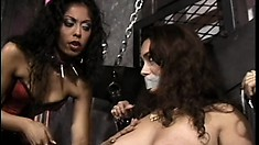 Dominatrix Lita Young gives her slave Trisha Post some rough treatment