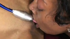Horny black bitches play around with some very long sex toys