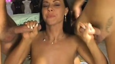 Hot babe gets nailed hard by two guys and takes their cum in her mouth