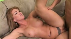 Buxom blonde cougar has a young guy fulfilling all her sexual desires