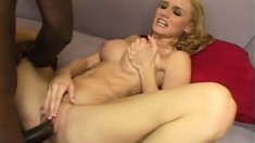 Well-endowed black fucker thrusts his cock into an innocent blonde