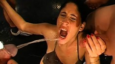 Freaky brunette bitch gets showered in piss during a wild orgy