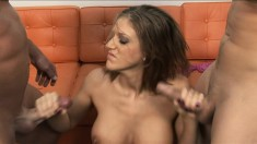 Stacked slut Eve Laurence takes two big cocks to orgasm with her hands