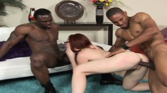 Horny redhead takes on two black dicks and gets hammered in a threesome