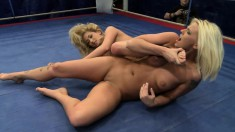 Busty blonde gets horny and lets her sexy opponent work her twat