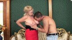 Insatiable blonde seduces a young buck and bangs him like a pro