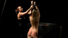 Nasty blonde dominatrix shoves a thick dildo in this hottie's mouth