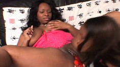 Two curvaceous ebony lesbians enjoying the taste of each other's cunts