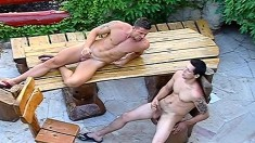 Gay couple in the backyard give head and shove it into a tight ass