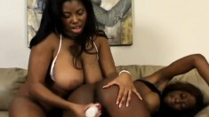 Hot ebony lesbian babes use their tongue and toys to knock one off