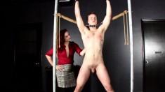 Kinky redheaded woman enjoys spanking this naughty dude's butt