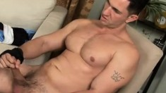 Muscled stallion sends his hands making his dick burst with pleasure