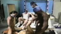Curvy ebony slut has a gang of interracial studs punishing her holes