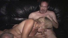 Bodacious and horny blonde milf getting gangbanged in a porn theater