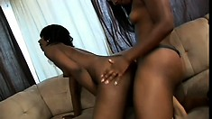 A pair of awesome ebony lesbians have some fun with a strap-on
