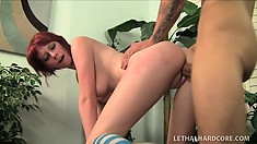 Naughty redheaded babe in stockings takes a monster cock in her ass