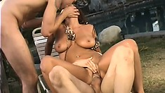 Busty brunette porn star gets fucked balls deep on a lounge chair