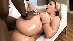 With her curvy body all oiled up, blonde milf Sara Jay gets fucked by a black stud