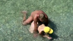 Nude girl picked up by voyeur cam at nude beach