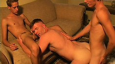 It gets wild and crazy in this gay threesome with a pair of twinks roasting a stud