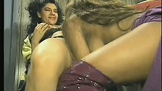 Feisty Latina gets wet while licking a sexy ebony chick's moist slit