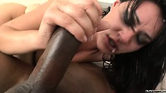 Juicy brunette slut with a thick bush gets it on with two cocks