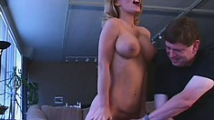Tanned broad with massive fake tits moans like crazy for the camera