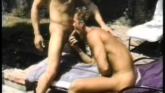 A pair of hung gay studs head outdoors for some rough anal pounding
