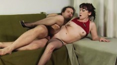 Luscious mature lady tongues a stud's ass and fucks his throbbing cock