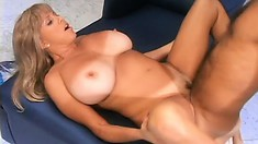 Big breasted blonde milf sucks and rides a long shaft with excitement