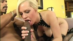 Cock hungry blonde enjoys feeding time with a huge black snake
