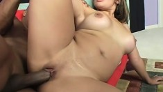 Voluptuous blonde gets her body all oiled up and fucks a black shaft