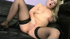 Appealing young girl in black stockings is rubbing her precious flytrap